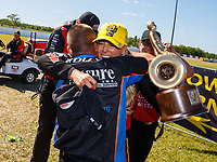 Apr 23, 2017; Baytown, TX, USA; NHRA top fuel driver Leah Pritchett celebrates with funny car driver Jim Campbell and crew members after winning the Springnationals at Royal Purple Raceway. Mandatory Credit: Mark J. Rebilas-USA TODAY Sports