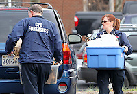 CHARLOTTESVILLE, VA - FEBRUARY 17:  Members of the Charlottesville Police department carry containers of evidence to the Charlottesville Circuit courthouse for the George Huguely trial. Huguely was charged in the May 2010 death of his girlfriend Yeardley Love. She was a member of the Virginia women's lacrosse team. Huguely pleaded not guilty to first-degree murder. (Credit Image: © Andrew Shurtleff