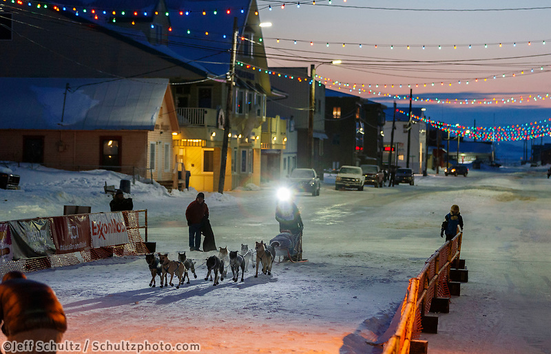 Matthew Failor runs down Front Street as he arrives in the finish chute in Nome in 59th place during the 2017 Iditarod on Saturday March 18, 2017.<br /> <br /> Photo by Jeff Schultz/SchultzPhoto.com  (C) 2017  ALL RIGHTS RESERVED