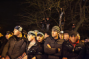 Boys watch the first legal street car race, which took place in Grozny in March 2012. Approximately 10 000 men attended. Grozny, Chechnya, Russia, 2010