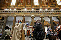 Mass celebrated at the Basilica of Santa Maria in Trastevere<br /> Roma May 18th 2020. Covid-19 Italy further relaxes lockdown. Today a Council of Minister's decree will allow almost all the activity to reopen. Clothes shops, shopping centers, hairdresser and churches for religious services. <br /> Photo Samantha Zucchi Insidefoto