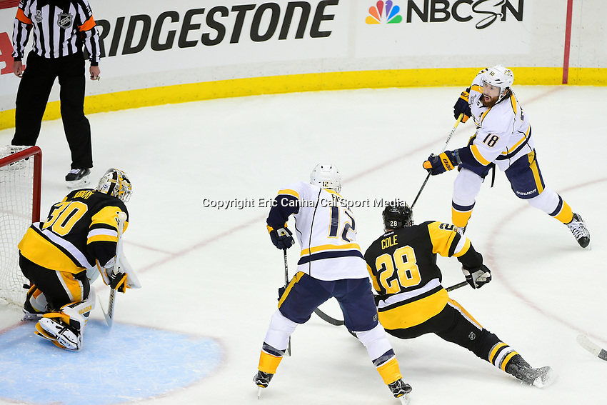 May 31, 2017: Nashville Predators left wing James Neal (18) takes a shot on Pittsburgh Penguins goalie Matt Murray (30) during game two of the National Hockey League Stanley Cup Finals between the Nashville Predators  and the Pittsburgh Penguins, held at PPG Paints Arena, in Pittsburgh, PA. The Penguins defeat the Predators 4-1 and lead the series 2-0. Eric Canha/CSM