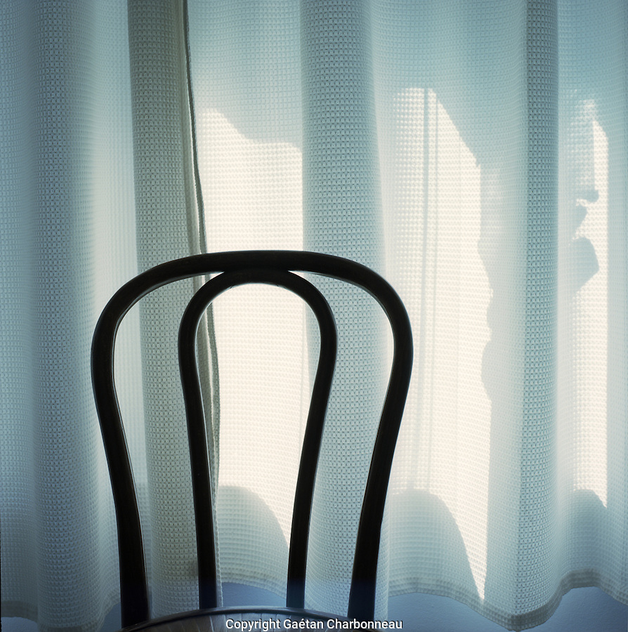 Bistro chair in front of a curtain