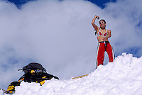 Woman dancing in Snow beside Snowmobile near Brohm Ridge, Garibaldi Provincial Park, near Squamish, BC, British Columbia, Canada (No Model Release Available)