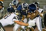 Lawndale, CA 10/18/13 - Khalil Miller (Leuzinger #21) and Luke Megginson (Peninsula #78) in action during the Peninsula vs Leuzinger Varsity football game at Leuzinger High School.
