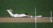 25th March 2018, Auckland, New Zealand;  Henry Nicholls dives as he avoids being run out. New Zealand versus England. 1st day-night test match. Eden Park, Auckland, New Zealand. Day 4