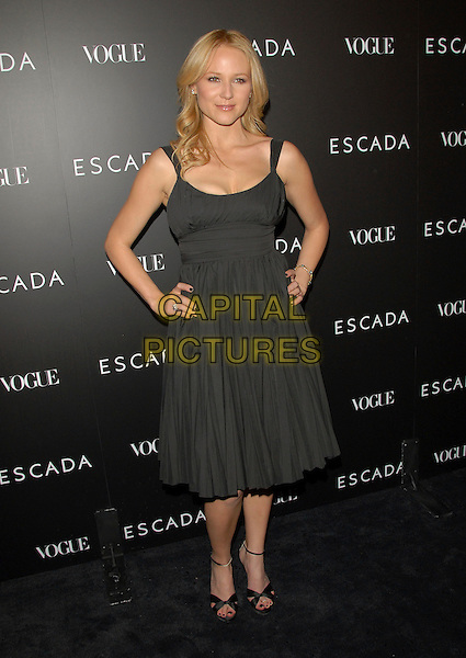 JEWEL.The Grand Opening of The Escada Beverly Hills Flagship Boutique at The Beverly Wilshire Hotel in Beverly Hills, California, USA. .May 3rd, 2007.full length black dress hands on hips  .CAP/DVS.©Debbie VanStory/Capital Pictures
