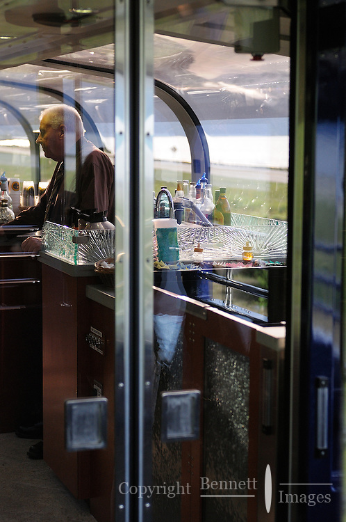 Michael Devitt  staffs the refreshments area on the Alaska Railroad's Goldstar first-class railcar.