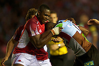 Joe Ajuwa of London Welsh tackles Ugo Monye of Harlequins during the Aviva Premiership match between Harlequins and London Welsh at the Twickenham Stoop on Friday 7th September 2012 (Photo by Rob Munro)