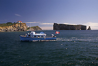 Gaspe Peninsula, Perce, Quebec, Canada, Rocher Perce, Gulf of St. Lawrence, Excursion boat heading back from a tour of Perce Rock (Rocher Perce) on the Gulf of St. Lawrence in Perce on Gaspe Peninsula in Quebec.