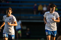 Seattle, Washington -  Sunday, September 11 2016: Seattle Reign FC midfielder Keelin Winters (11) and Seattle Reign FC forward Nahomi Kawasumi (36) piror to a regular season National Women's Soccer League (NWSL) match between the Seattle Reign FC and the Washington Spirit at Memorial Stadium. Seattle won 2-0.