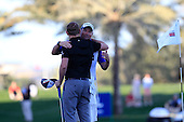 Stephen Gallacher (SCO) hugs his caddy after winning the tournament by 3 shots with a score  of -22 at the end of Sunday's Final Round of the 2013 Omega Dubai Desert Classic held at the Emirates Golf Club, Dubai, 3rd February 2013..Photo Eoin Clarke/www.golffile.ie