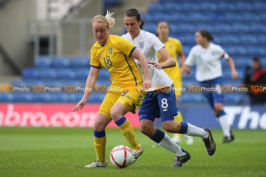 Marie Hammarstrom of Sweden and Jill Scott of England - England Women vs Sweden Women - International Football at Oxford United FC - 17/05/11 - MANDATORY CREDIT: Gavin Ellis/TGSPHOTO - Self billing applies where appropriate - Tel: 0845 094 6026