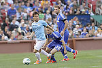 23 May 2013:  David Silva (left)(ESP) of Manchester City moves the ball past Cesar Azpilicueta (28)(ESP) and Branislav Ivanovic (2)(SRB) of Chelsea.  Chelsea F.C. was defeated by Manchester City 3-4 at Busch Stadium in Saint Louis, Missouri, in a friendly exhibition soccer match.
