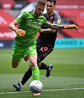 15th July 2020; Ashton Gate Stadium, Bristol, England; English Football League Championship Football, Bristol City versus Stoke City; Lee Gregory of Stoke City competes for the ball with Daniel Bentley of Bristol City