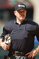 Home plate umpire Jim Garman waits for the signal from the TV crew that the game between the Sam Houston State Bearkats and the Texas Tech Red Raiders can resume at Minute Maid Park on March 1, 2014 in Houston, Texas.  The Bearkats defeated the Red Raiders 10-6.  (Brian Westerholt/Four Seam Images)