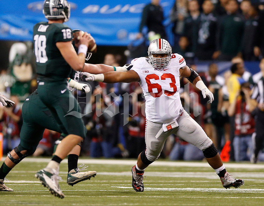 Ohio State Buckeyes defensive lineman Michael Bennett (63) rushes Michigan State Spartans quarterback Connor Cook (18) during the first quarter of the Big Ten championship football game at Lucas Oil Stadium in Indianapolis on Dec. 7, 2013. (Adam Cairns / The Columbus Dispatch)