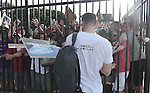 Ichiro Suzuki (Marlins),<br /> FEBRUARY 24, 2014 - MLB :<br /> Ichiro Suzuki of the Miami Marlins wears a t-shirt reading &quot;Please continue your support&quot; as he signs autographs for fans after practice during the Miami Marlins spring training camp in Jupiter, Florida, United States. (Photo by AFLO)