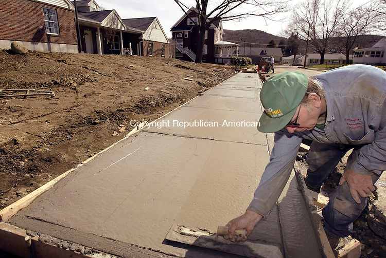 WINSTED, CT- 08 APRIL 2005-040805J01--Workers from Torrington Concrete Foundation of Winsted, work on laying the sidewalk outside the Laurel Commons housing project in Winsted on Friday. Workers are putting the finishing touches on the project. 15 units in the senior center housing community are already occupied.  --- Jim Shannon Photo-- are CQ