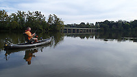 NWA Democrat-Gazette/FLIP PUTTHOFF <br /> McBride fishes Sept 24 2015 near the one-lane bridge that spans Lake Sequoyah.