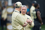 Wake Forest Demon Deacons assistant head coach Kevin Higgins (right) chats with head coach Dave Clawson prior to the game against the Louisville Cardinals at BB&T Field on October 28, 2017 in Winston-Salem, North Carolina.  The Demon Deacons defeated the Cardinals 42-32.  (Brian Westerholt/Sports On Film)