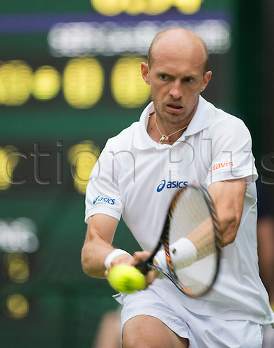 26.06.2012. The Wimbledon Tennis Championships 2012 held at The All England Lawn Tennis and Croquet Club, London, England, UK.  ..Andy Murray (GBR) [4] v Nikolay Davydenko (RUS). Nikolay in action. ..