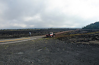 An older man with a red truck stops along Saddle Road, Big Island.