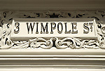 Ornate old white stone sign for 3 Wimpole Street, London, England
