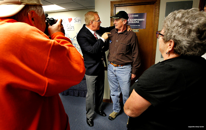 Former Ohio Gov Ted Strickland, left center, campaigning in NH for Obama, talks with Vietnam veteran Tom Scanlon, right, at a phone bank in Salem, N.H.,  Thursday, Sept. 27, 2012. (Cheryl Senter for the Boston Globe)