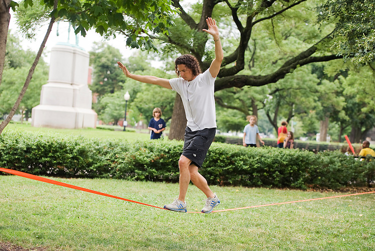 "UNITED STATES - JUNE 20:  Seth de Matties, a Library of Congress employee, walks a slackline or ""slacklines,"" in Stanton Park on Capitol Hill.  (Photo By Tom Williams/Roll Call)"