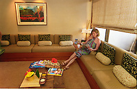 Woman relaxing & drinking hot tea before a massage at the Mauna Lani spa