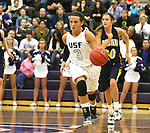 SIOUX FALLS, SD - JANUARY 2:  Taylor Varsho #3 from the University of Sioux Falls pushes the ball past Logan O'Farrell #30 from Augustana in the first half of their game Friday night at the Stewart Center. (Photo by Dave Eggen/Inertia)