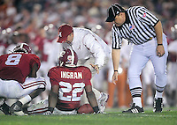 Jan 7, 2010; Pasadena, CA, USA; Alabama Crimson Tide running back Mark Ingram (22) is checked on by a trainer after being injured during the third quarter of the 2010 BCS national championship game against the Alabama Crimson Tide at the Rose Bowl.  Mandatory Credit: Mark J. Rebilas-