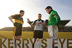 Brian Looney Dr. Crokes Referee Derek O'Mahony and Brian Morgan Nemo Rangers in their AIB Senior Club Football Championship Munster Final at Mallow GAA Grounds on Sunday 30th January 2011.
