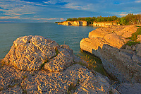 Limestone cliffs along Lake Manitoba at sunset<br />