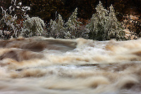 Spring melt on the Gooseberry River in Gooseberry Falls State Park, Minnesota, USA.