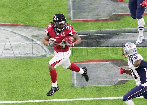 February 5th 2017, Houston, Tezas, USA;   Atlanta Falcons running back Devonta Freeman (24) runs the ball during the New England Patriots 34-28 victory over the Atlanta Falcons