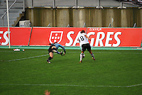Germany's Grings scores on USA goalkeeper Hope Solo.  The USA captured the 2010 Algarve Cup title by defeating Germany 3-2, at Estadio Algarve on March 3, 2010.