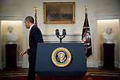 United States President Barack Obama walks away from the podium after making a live statement to the nation concerning historic changes in U.S. relations with Cuba in the Cabinet Room of the White House in Washington, D.C. on Wednesday, December 17, 2014.  In his remarks the President announced he planned to start talks with Cuba to normalize ties and open an embassy as a result of the release of Alan Gross. <br /> Credit: Doug Mills / Pool via CNP