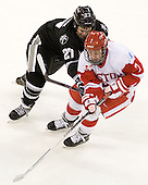 Alex Velischek (PC - 27), Cason Hohmann (BU - 7) - The Boston University Terriers defeated the visiting Providence College Friars 4-2 (EN) on Saturday, December 13, 2012, at Agganis Arena in Boston, Massachusetts.
