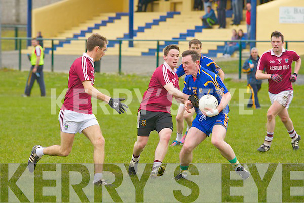Padraig McCarthy (Ballymacelligott) in action with Padraig O'Sullivan (Dromid) on Sunday at Ballymacelligott GAA grounds in the div3- 5th round Football League