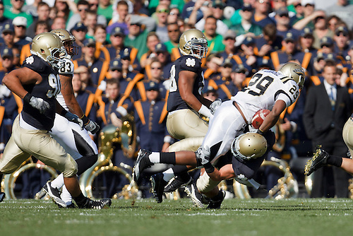 Notre Dame safety Zeke Motta (#17) makes tackle on Western Michigan running back Tevin Drake (#29) during NCAA football game between Western Michigan and Notre Dame.  The Notre Dame Fighting Irish defeated the Western Michigan Broncos 44-20 in game at Notre Dame Stadium in South Bend, Indiana.
