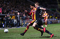 Tim Dieng of Bradford City and Dan Burn of Wigan challenge for the ball during the Sky Bet League 1 match between Bradford City and Wigan Athletic at the Northern Commercial Stadium, Bradford, England on 14 March 2018. Photo by Thomas Gadd.