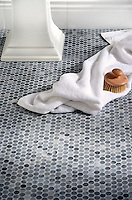 Pennyrounds, a handmade mosaic shown in polished Greystoke, is part of The Studio Line of Ready to Ship mosaics.<br />