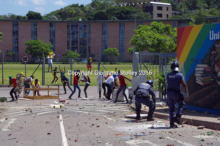DURBAN - 10 October 2016 - Police officers retreat from The Oval residence at the University of KwaZulu-Natal's Westville campus after almost being overwhelmed by stone throwing students. South Africa's tertiary institutions have been gripped by ongoing protests against university fees and a host of other complaints. Picture: Allied Picture Press/APP