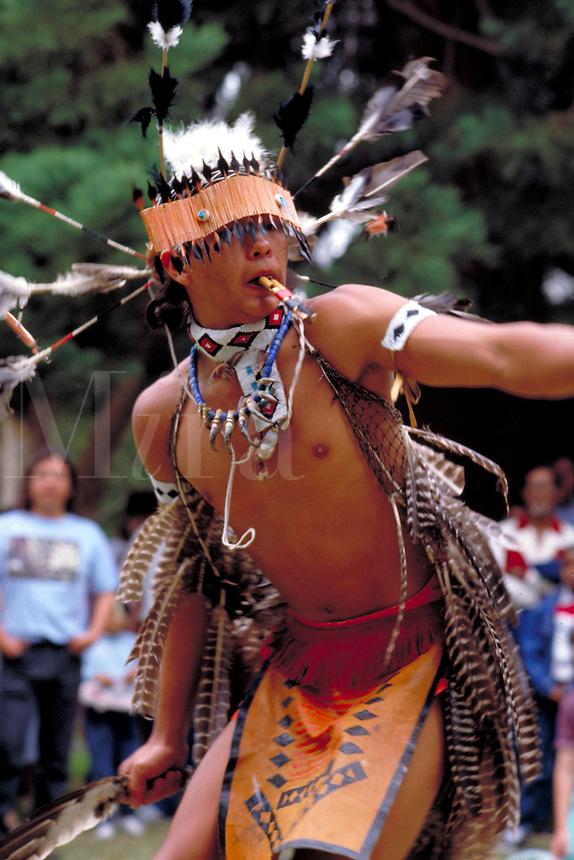 Coast Miwok Nation dancer performs at powwow. Oakland, California