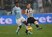 Balde Keita  and  Stephan Lichtsteiner    in action during the Italian Serie A soccer match between   SS Lazio and FC Juventus   at Olimpico  stadium in Rome , November 22, 2014