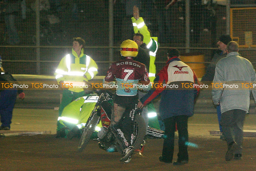 Leigh Lanham of Ipswich is injured in a crash during Heat 8. Stuart Robson of Lakeside (7) can be seen talking to Leigh Lanham's mechanic (in front of paramedic with arms raised) immediately after the incident - Ipswich Witches vs Lakeside Hammers - Speedway Challenge Match First Leg at Foxhall Stadium, Ipswich, Suffolk - 19/03/09 - MANDATORY CREDIT: Gavin Ellis/TGSPHOTO - Self billing applies where appropriate - 0845 094 6026 - contact@tgsphoto.co.uk - NO UNPAID USE.