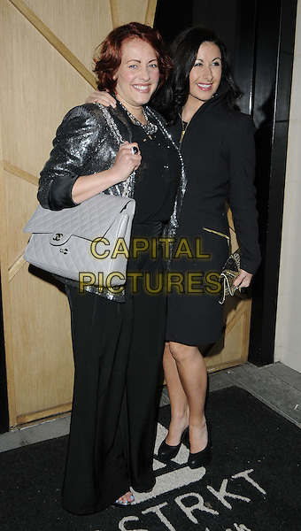 Sarah Cawood & Hayley Tamaddon.Nick Ede's Birthday Party at DSTRKT Restaurant, Rupert Street, London, England..May 2nd 2012.full length silver jacket black grey gray bag purse trousers.CAP/CAN.©Can Nguyen/Capital Pictures.