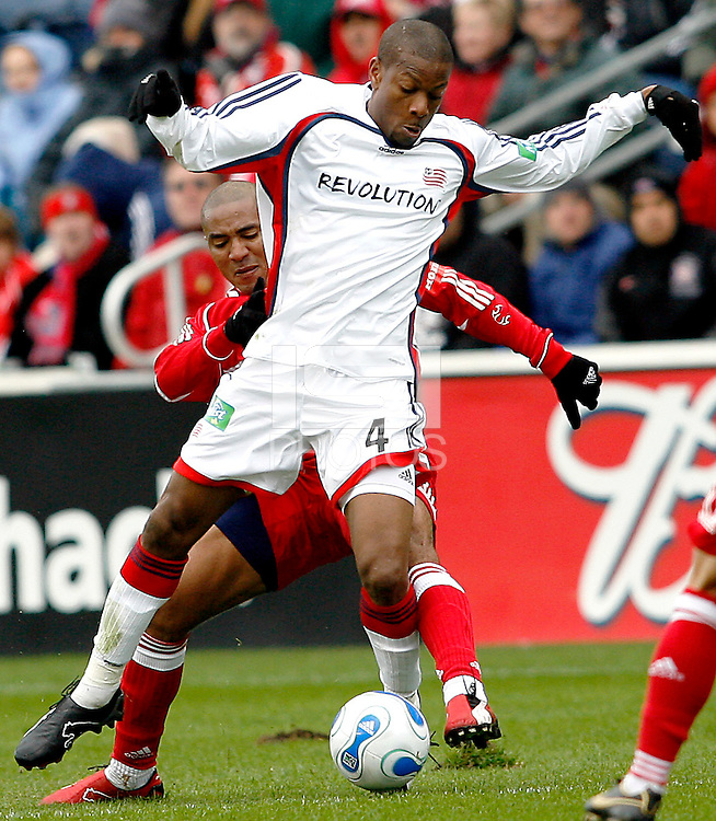 Chicago Fire forward Andy Herron (26) attempts to knock the ball away from New England Revolution defender Avery John (4).  The Chicago Fire defeated the New England Revolution 1-0 in the first game of their playoff series at Toyota Park in Bridgeview, IL on October 22, 2006..